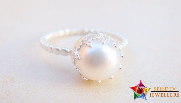 Wearing Pearl Gemstone Ring