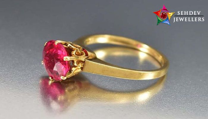 wearing ruby gemstone ring